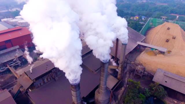 Smoke chimneys with white smoke while sugar produce video