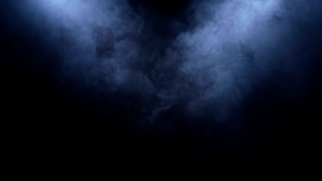 Smoke clears in the spotlight on black background video