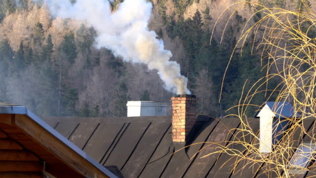 Smoke comes from the chimney. The pipe on the roof. Chimney. Smoke comes from the chimney. The pipe on the roof. Chimney. smokehouse stock videos & royalty-free footage