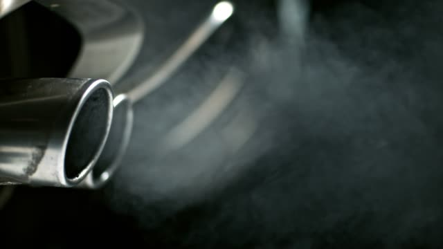 SLO MO Smoke coming from the car exhaust pipes