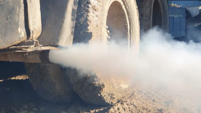 Smoke coming out of the exhaust pipe of the Pollution truck. Exhaust from the truck.
