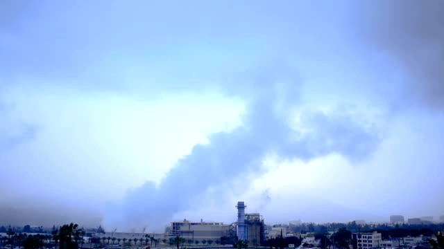 Smoke filling the skies from industrial power plant video