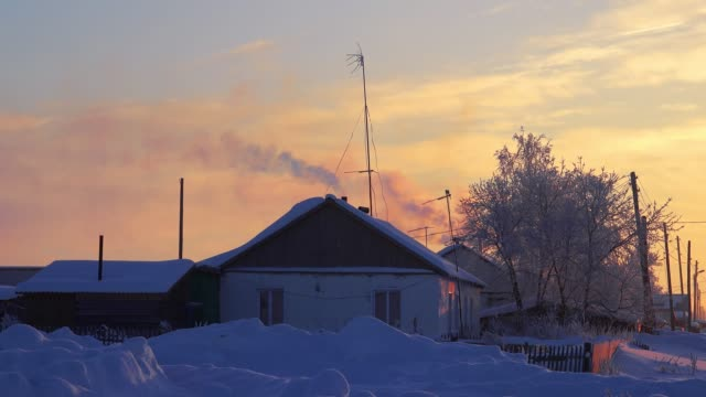 Smoke from the chimney of russian country house izba in Altai village Semiletka Smoke from the chimney of russian country house izba in Altai village Semiletka, Siberia, Russia siberia stock videos & royalty-free footage
