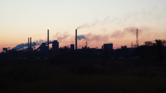 smoke from the chimneys of a metallurgical plant - metallurgia video stock e b–roll