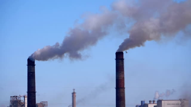 Video Smoke from the Chimneys of Industrial Metallurgical Plant Rises in the Atmosphere near the City