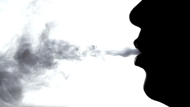 Smoke from the man mouth, close up, silhouette, slow motion Smoke from the man mouth, close up, silhouette, on white background, slow motion weeding stock videos & royalty-free footage