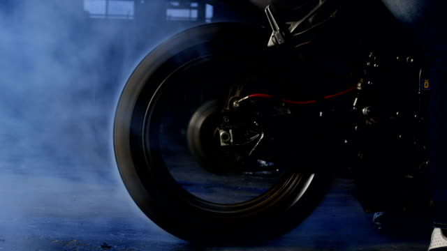 Smoke from under the motorcycle wheels Smoke from under the motorcycle wheels motorcycle stock videos & royalty-free footage
