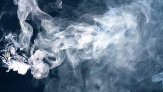 Smoke in slow motion. Smoke on black. White smoke