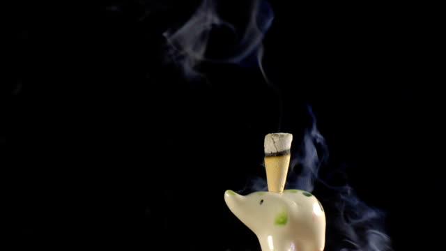 Smoke incense cone in ceramic statuette of elephant loop video