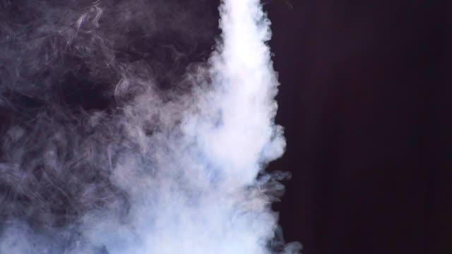 Smoke on black background in blue light