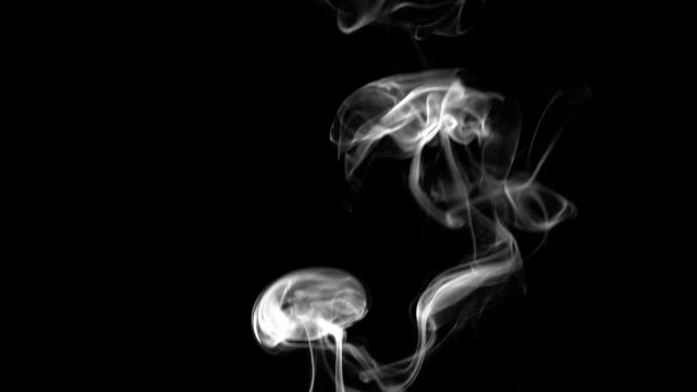 Smoke on black background. Slow motion video