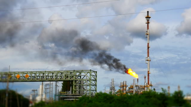 Smoke pollution blowing from flare structure of refinery plant Smoke pollution blowing from flare structure of refinery plant ,video for industrial business and environment concept flare stack stock videos & royalty-free footage