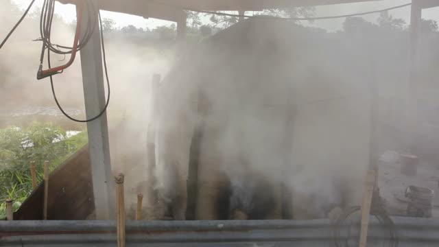 smoke rising from the clay oven. - биомасса возобновляемая энергия стоковые видео и кадры b-roll