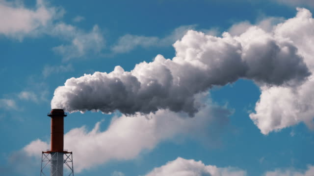 Smoke stack from industrial chimney, air pollution problem