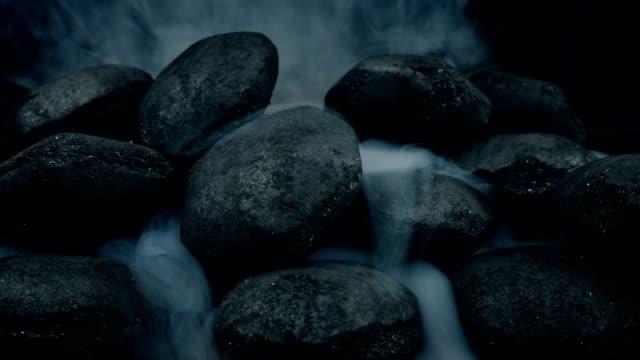 Smoke Starts To Come Through Coal Pile video