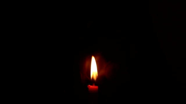 smoke with candle light isolated black smoke with candle light isolated black candle stock videos & royalty-free footage