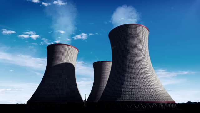smoked cooling tower of nuclear power plant, thermal power plant, cloud sky view image. - centrale elettrica video stock e b–roll