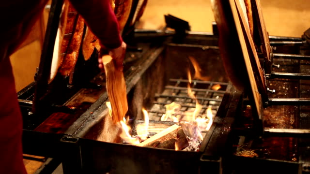 Smoked fish on fire video