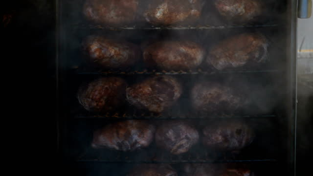 Smoked Meats Pork in a smoker for pulled pork sandwiches smokehouse stock videos & royalty-free footage