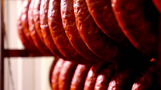 Smoked sausage in the oven. Sausage production in the factory. Smoked sausage in the oven. Sausage production in the factory jerky stock videos & royalty-free footage