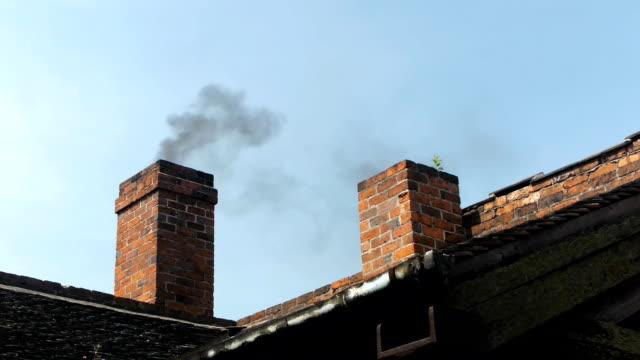 Smoking brick chimney.