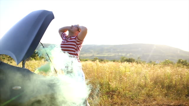 Smoking car engine causes panic and confusion video