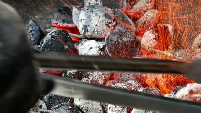 Smoking charcoal Smoking charcoal, close up coal stock videos & royalty-free footage