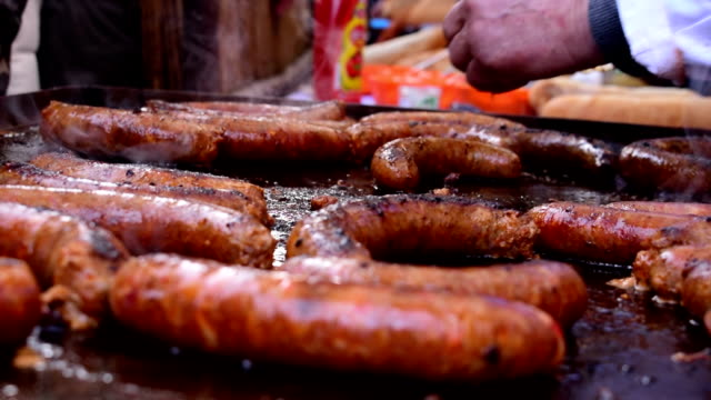 Smoking delicious sausage,turning and coating sausages on the grill Smoking delicious sausage,turning and coating sausages on the grill roast dinner stock videos & royalty-free footage