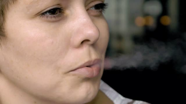 Smoking female with a cigarette in her hand video