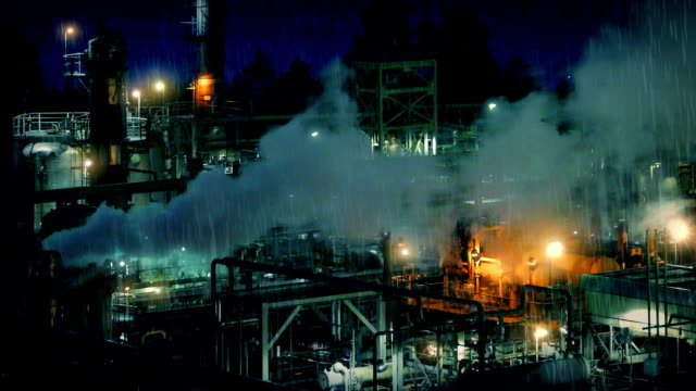 Smoking Industrial Facility At Night video