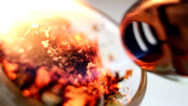 Smoking pot being burned close up video