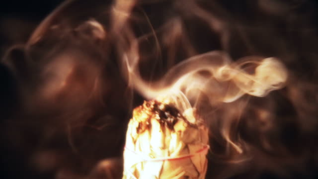 Smoking Sage Close up of sage bundle burning with smoke rising. minority groups stock videos & royalty-free footage