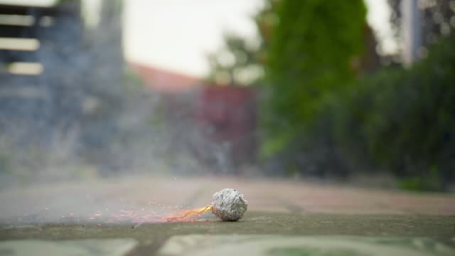 Smoky bomb explosion in slow motion outdoors Smoky bomb explosion in slow motion outdoors. firework explosive material stock videos & royalty-free footage