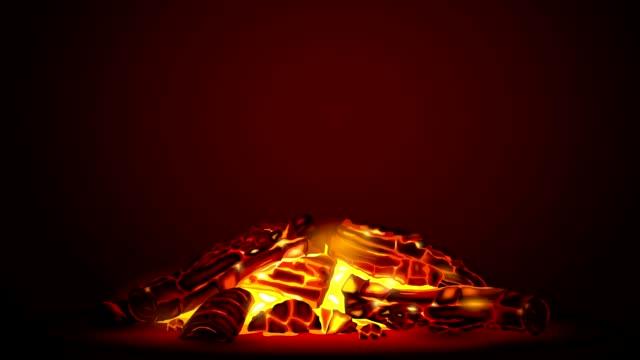 Smoldering fire at night video