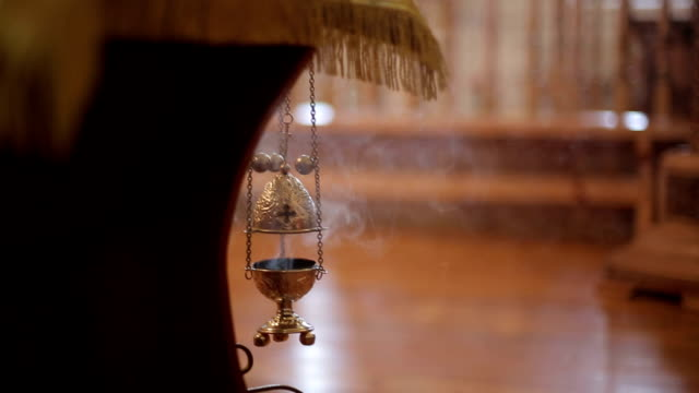 Smoldering incense in Christian church video