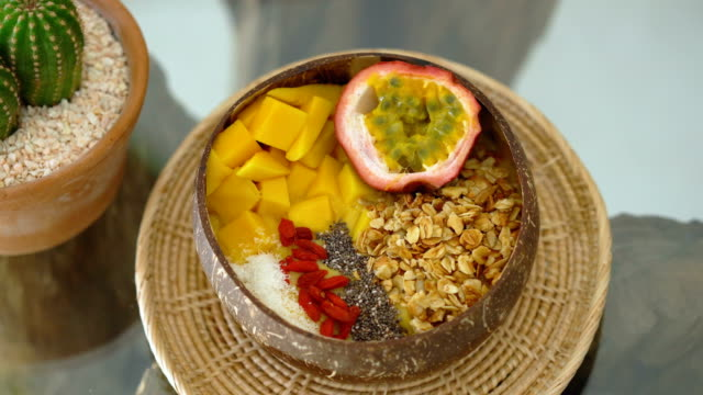 Smoothie bowl served in coconut shell
