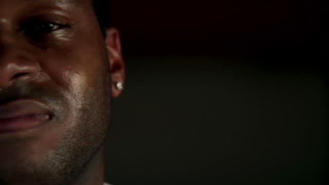 Smug, self-assured African American athlete video