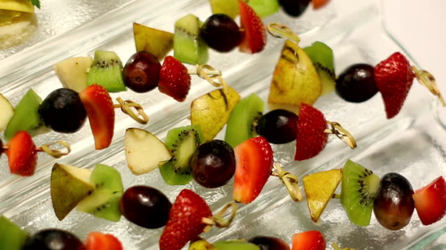 snacks with fruit on skewers lying snacks with fruit on skewers lying on the glass table skewer stock videos & royalty-free footage
