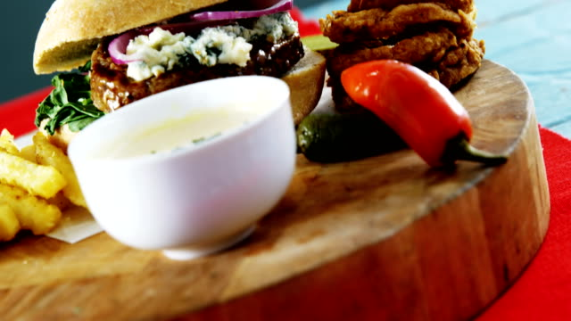 Snacks with mayonnaise on wooden board video