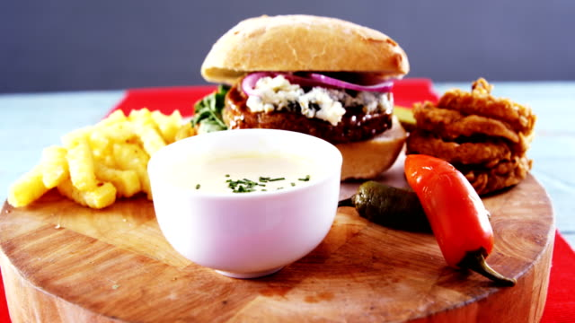 Snacks with mayonnaise on wooden board Close-up of snacks with mayonnaise on wooden board dipping sauce stock videos & royalty-free footage