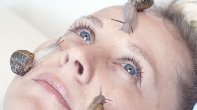 snail mucus the new skincare trend - facial stock videos & royalty-free footage