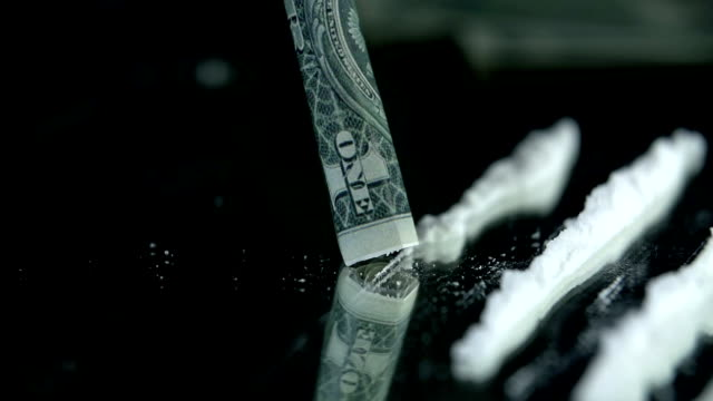 HD SLOW: Sniffing the cocaine lines with a dollar bill video