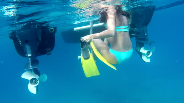 snorkel woman climbing ladder into boat in Virgin Gorda video