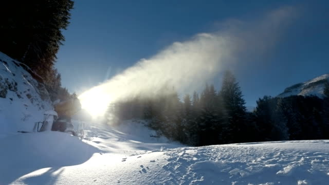 Snow cannon against the blue sky and sun video