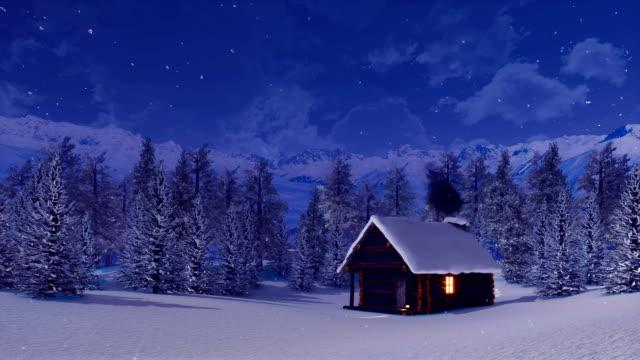 vídeos de stock e filmes b-roll de snow covered alpine mountain house at snowfall winter night - isolated house, exterior