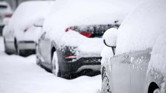 Snow covered cars during snowfall video