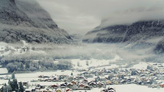 Snow Covered Chalets in Alpine Valley - Interlaken, Switzerland video