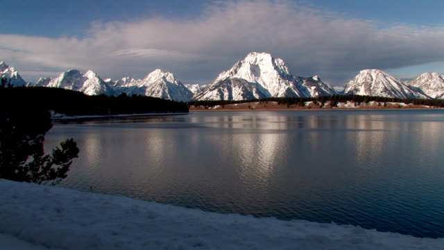 Snow covered mountains by a lake video