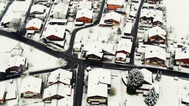 Snow Covered Rooftops in Gsteigwiler, Switzerland video