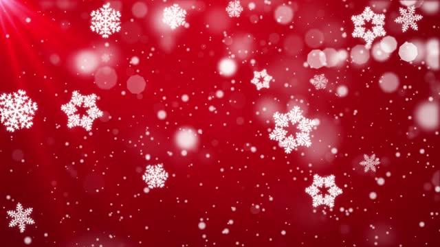stockvideo's en b-roll-footage met sneeuw die op blauwe hemel met deeltjes in de achtergrond van de de kring van de winterkerst valt - sneeuwkap